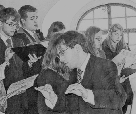 The the Chamber Choir Würzburg under the direction of Matthias Beckert during service